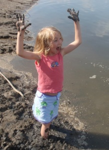Kiera playing in mud