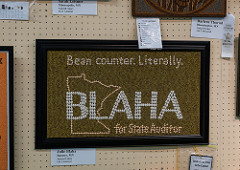 "A mosaic made from beans and seeds that says ""Bean counter. Literally. BLAHA for State Auditor."""