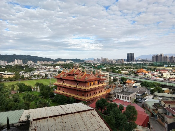 A view of a temple in Taipei, taken from a balcony.
