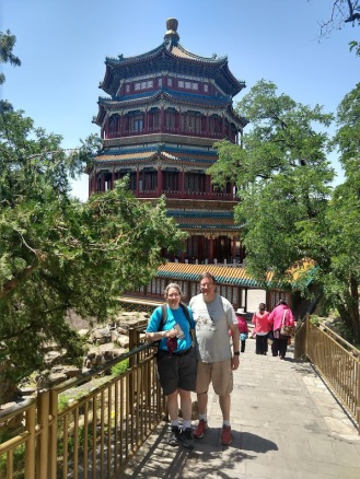 Me and Ed, in front of the Tower of Buddhist Incense, a tall, fancy building.
