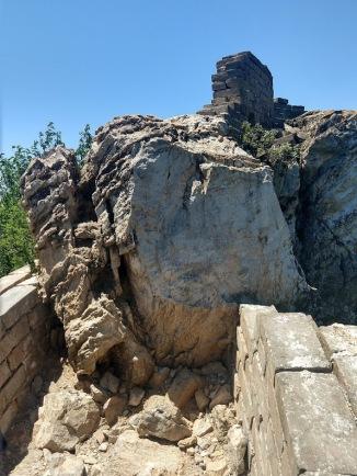 It looks like a giant rock has fallen onto the wall, blocking it.